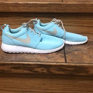 Baby blue Nike tennis shoes